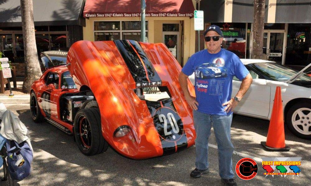 Photo of First Impressions personal cinema firm Jeffrey Smith, standing beside a classic sportscar.